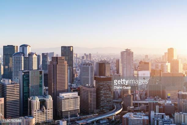 sunset in osaka - 大阪 ストックフォトと画像