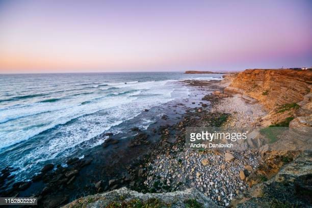 sunset in peniche. rocky cliffs and the ocean. - leiria district stock photos and pictures