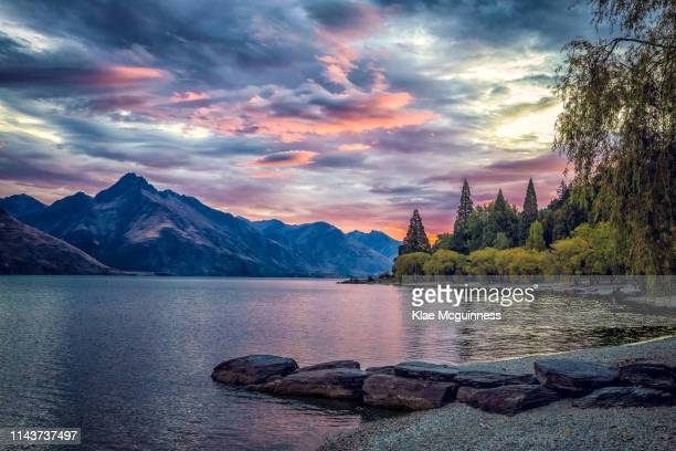 sunset in queenstown new zealand - queenstown stock pictures, royalty-free photos & images