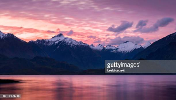 sunset in queenstown nz - queenstown stock pictures, royalty-free photos & images