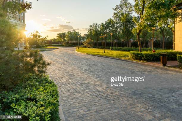 sunset in residential district - public park stock pictures, royalty-free photos & images