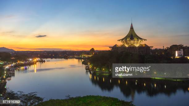 sunset in sarawak river in kuching - sarawak state stock pictures, royalty-free photos & images
