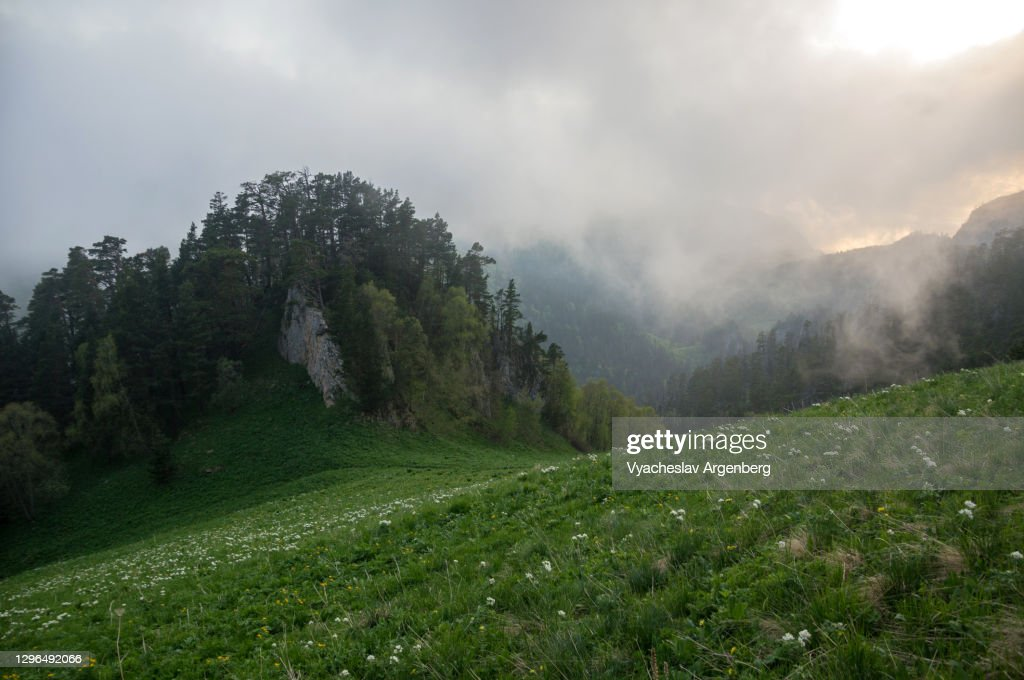 Sunset in Shisha Valley with clouds and fog, Caucasus Biosphere Reserve : Stock Photo