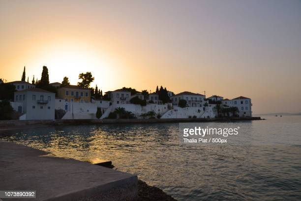 sunset in spetses island - spetses stock pictures, royalty-free photos & images
