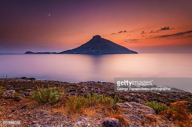 sunset in telendos island greece - dodecanese islands stock photos and pictures