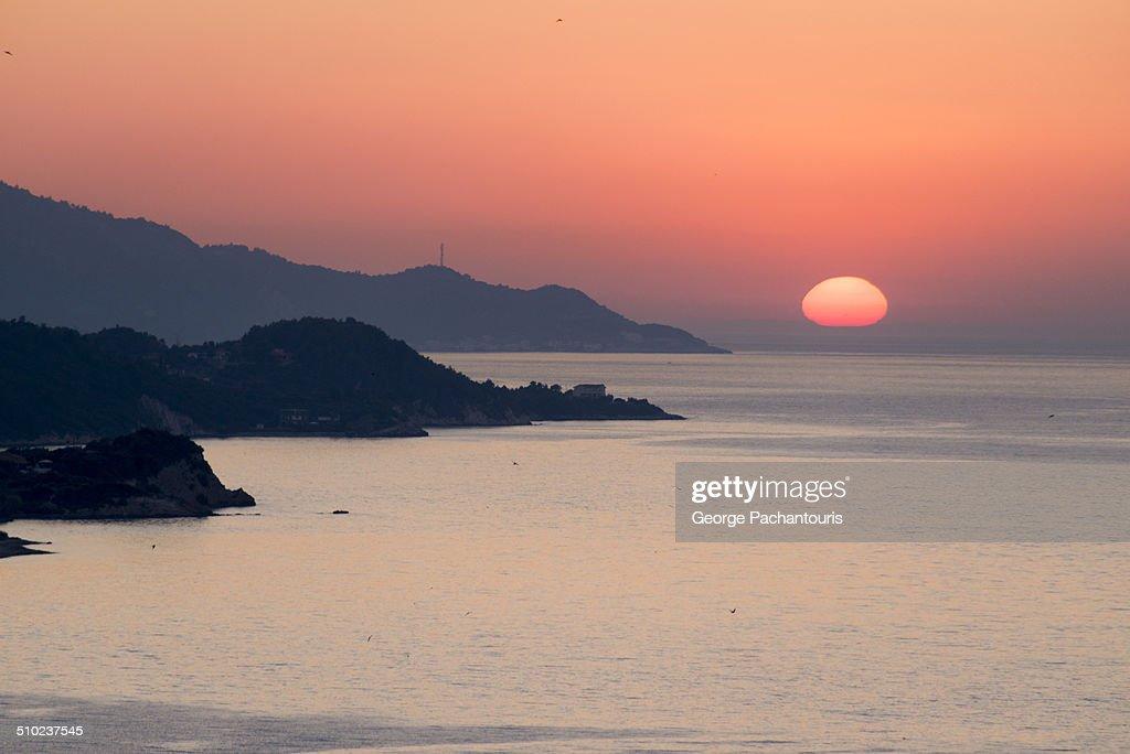 Sunset in the Aegean sea : Stock Photo