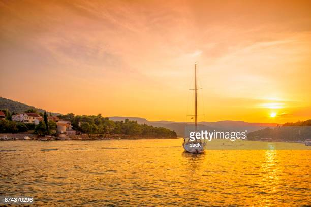 sunset in the bay of stari grad, hvar (croatia) - hvar stock photos and pictures