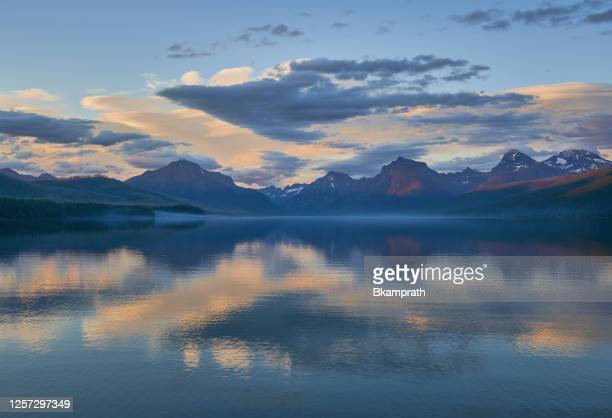 sunset in the beautiful natural scenery of glacier national park's lake mcdonald area during the summer in montana, usa. - romantic sunset stock pictures, royalty-free photos & images