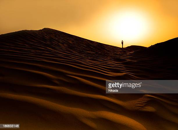sunset in the desert - uncultivated stock pictures, royalty-free photos & images