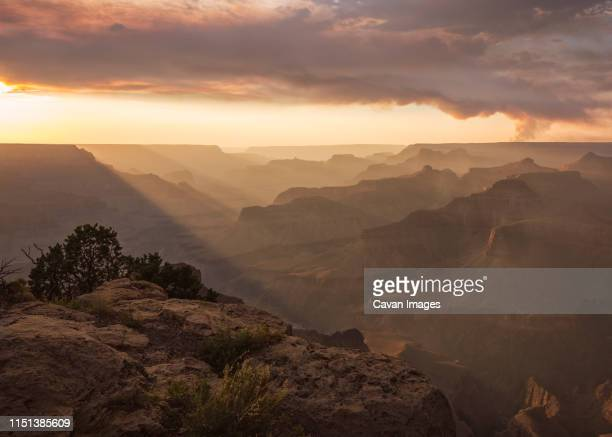 sunset in the grand canyon with some fire smoke. - valley stock pictures, royalty-free photos & images