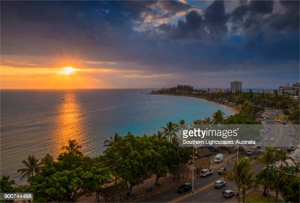 sunset in the harbour of the city of noumea, new caledonia, south pacific. - new caledonia stock photos and pictures