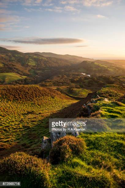 sunset in the hills of snowdonia, north wales - north wales stock pictures, royalty-free photos & images