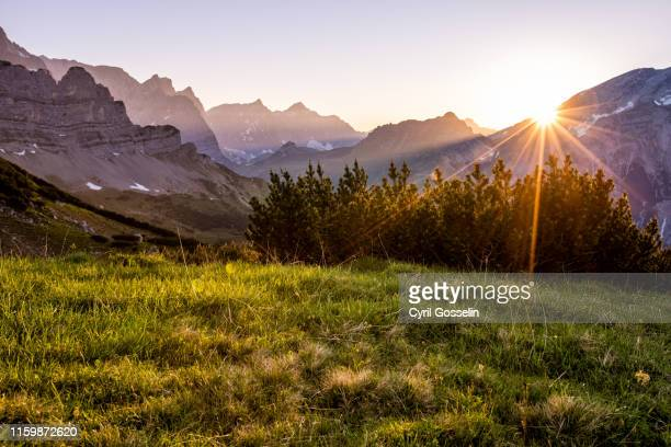 sunset in the karwendel mountain range - karwendel mountains stock pictures, royalty-free photos & images
