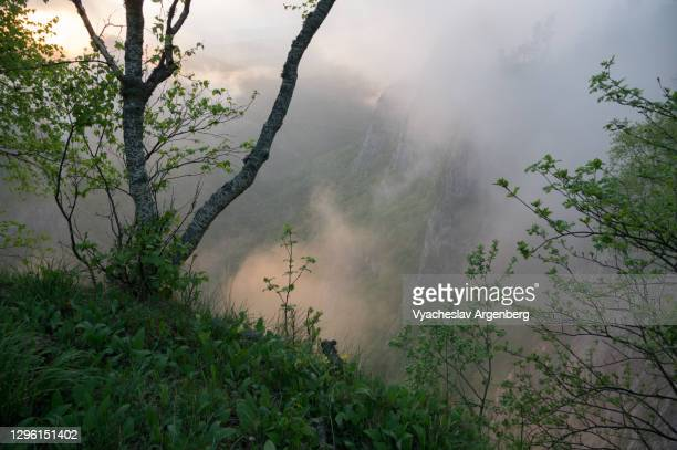 sunset in the mountains, afterglow through the clouds, western caucasus - argenberg stock pictures, royalty-free photos & images