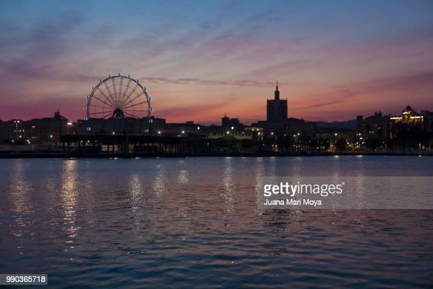 sunset in the port of the city of malaga. - malaga fotografías e imágenes de stock