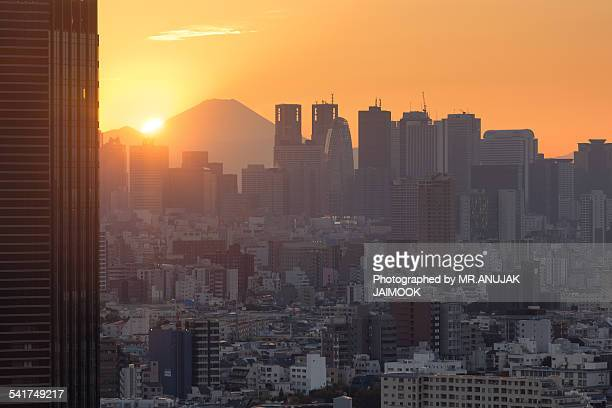 sunset in tokyo with mt.fuji in background - narita stock photos and pictures