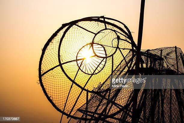 Sunset in Vientiane seen through fishing nets