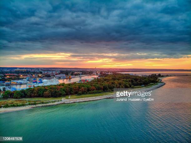 sunset in westerplatte beach - gdansk stock pictures, royalty-free photos & images