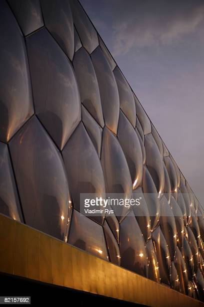 A sunset is reflected on the exterior of the National Aquatics Centre ahead of the Beijing 2008 Olympic Games on August 2 2008 in Beijing China