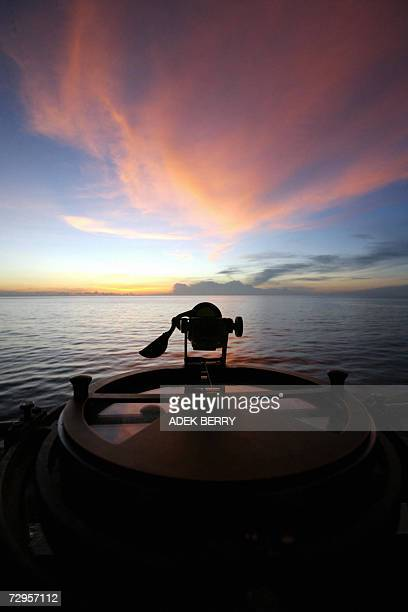 Sunset is seen from the KRI Fatahillah as a search and rescue operation continues for the missing Adam air plane on Sulawesi sea 09 January 2007 A...