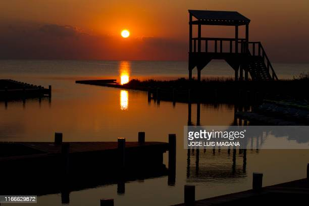 TOPSHOT A sunset is seen on the quiet water of the Rodanthe Sound shore after Hurricane Dorian crossed over Cape Hatteras in North Carolina on...
