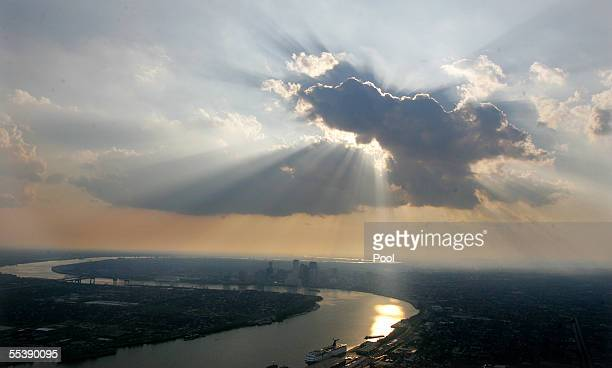 Sunset is seen over downtown September 12 2005 in New Orleans Louisiana US President George W Bush on a tour of devastated New Orleans rejected...