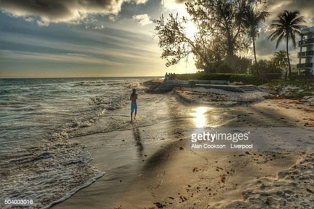 sunset jogger - bridgetown barbados stock photos and pictures