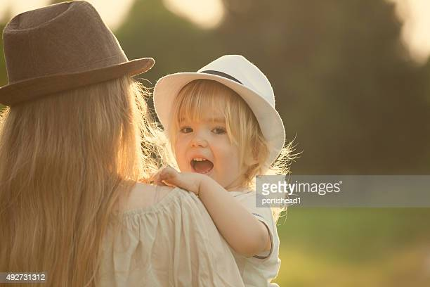 sunset joy - hot mom stock photos and pictures