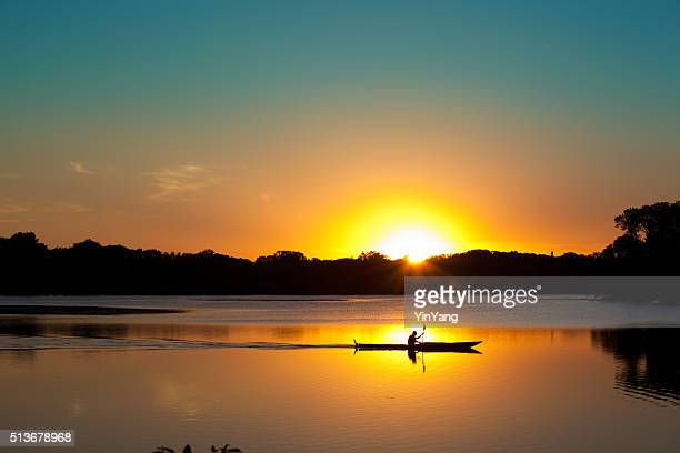 sunset kayaking in lake of the isles, minneapolis, minnesota - sunset lake stock photos and pictures