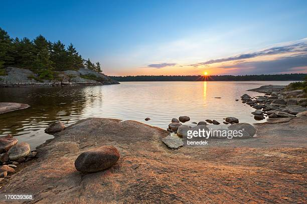 sunset lake landscape - north stock pictures, royalty-free photos & images