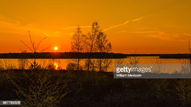 sunset lake - william mevissen stock pictures, royalty-free photos & images