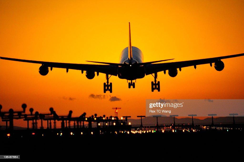 Sunset landing : Stock Photo
