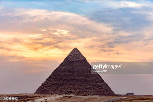 sunset landscape of sphinx and the great pyramid of giza  (the pyramids of khufu, khafre and menkaure,) near giza cairo egypt - ancient egyptian culture stock pictures, royalty-free photos & images