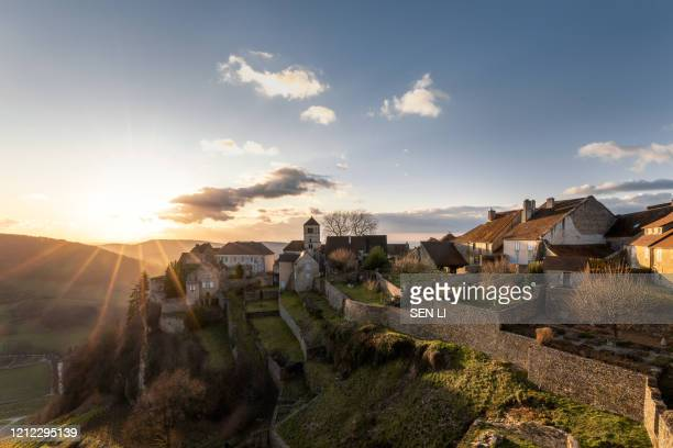 sunset landscapes of an ancient castle, medieval french town in chateau-chalon, burgundy, france - village stock pictures, royalty-free photos & images