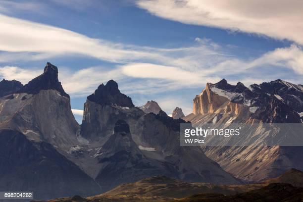Sunset light illuminates the yellow granite face of Monte Almirante Nieto At left are the Curenos del Paine with Monte Almirante Nieto on the right...