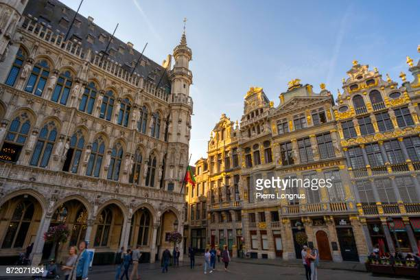 Sunset light on the baroque style facades of the 'Rue de la Tête d'Or' (English : Golden Head Street) with City Hall on the left, from The Grand Place, UNESCO World Heritage Site, Brussels, Belgium