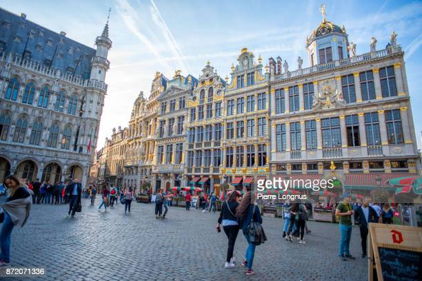 Sunset light on the facades of the 'Rue de la Tête d'Or' (English : Golden Head Street) from The Grand Place filled with tourists, UNESCO World Heritage Site, Brussels, Belgium