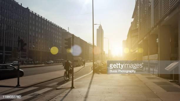 sunset light on via vittor pisani near milan central station. milan, italy - alba foto e immagini stock