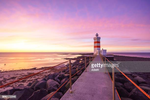 sunset lighthouse - lake superior stock pictures, royalty-free photos & images