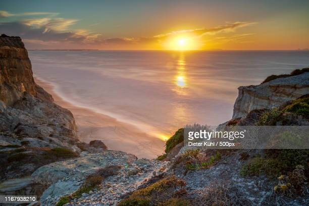 sunset living - rocky coastline stock pictures, royalty-free photos & images