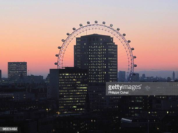 sunset, london eye. - london eye stock photos and pictures