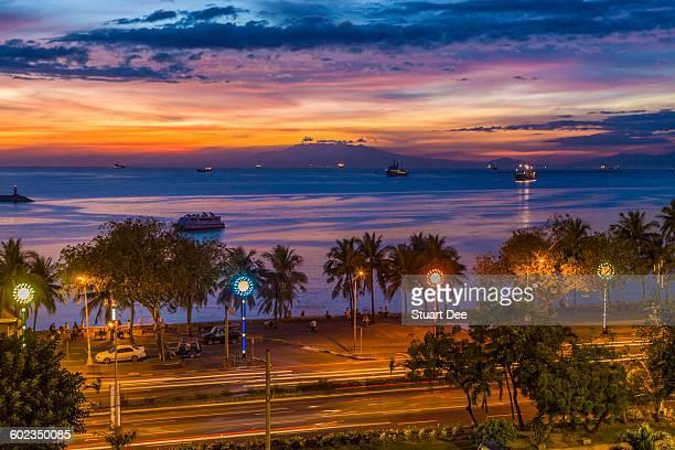 sunset, manila bay - manila bay stock photos and pictures
