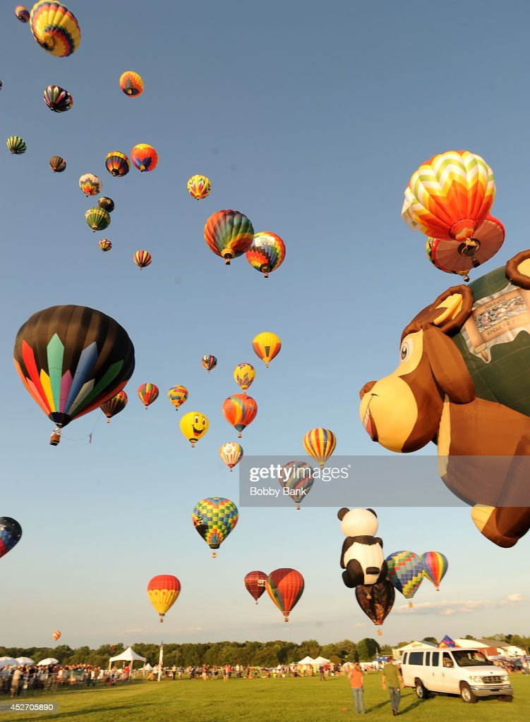 Sunset mass ascension of the 100 colorful sport and special shaped hot air balloons at the 2014 Quick Chek New Jersey Festival of Ballooning at Solberg Airport on July 25, 2014 in Readington, New Jersey.