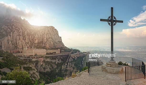 sunset montserrat monastery catalonia christian cross - catalonia stock pictures, royalty-free photos & images