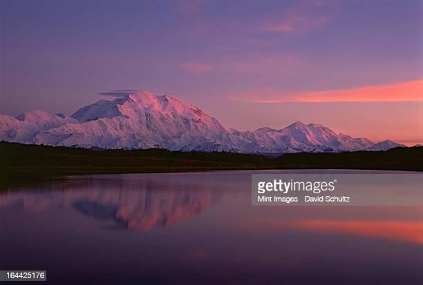 Sunset, Mount McKinley in Denali National Park, Alaska reflected in Reflection Pond.
