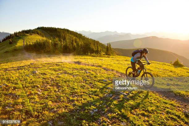 sunset mountain bike ride - cycling stock pictures, royalty-free photos & images