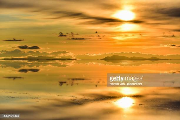 Sunset, mountains with reflection in the lake, water flooded salt lake, Salar de Uyuni, Altiplano, Bolivia