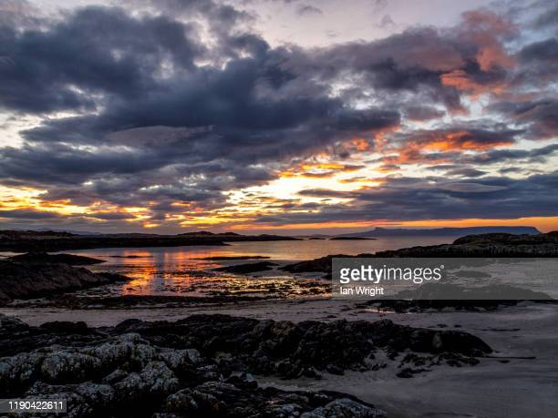sunset near arisaig - moment of silence stock pictures, royalty-free photos & images