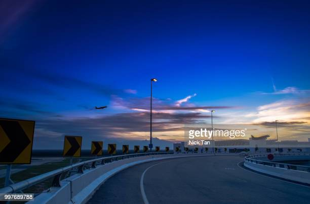 sunset near the kuala lumpur international airport - kuala lumpur international airport stock photos and pictures