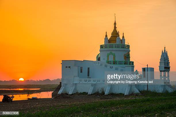 Sunset near the temple at U Bein bridge, Mandalay